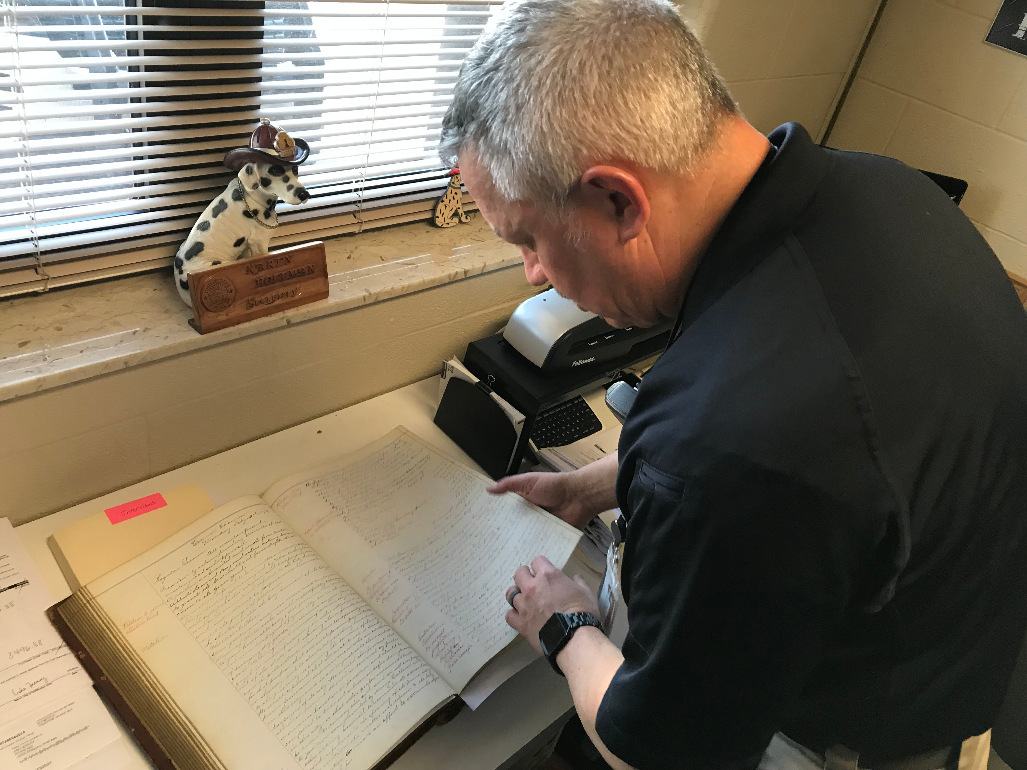 Chillicothe Fire Chief Jeff Creed looks over the city council notes from February 1879 when council approved creating the city's paid fire department.