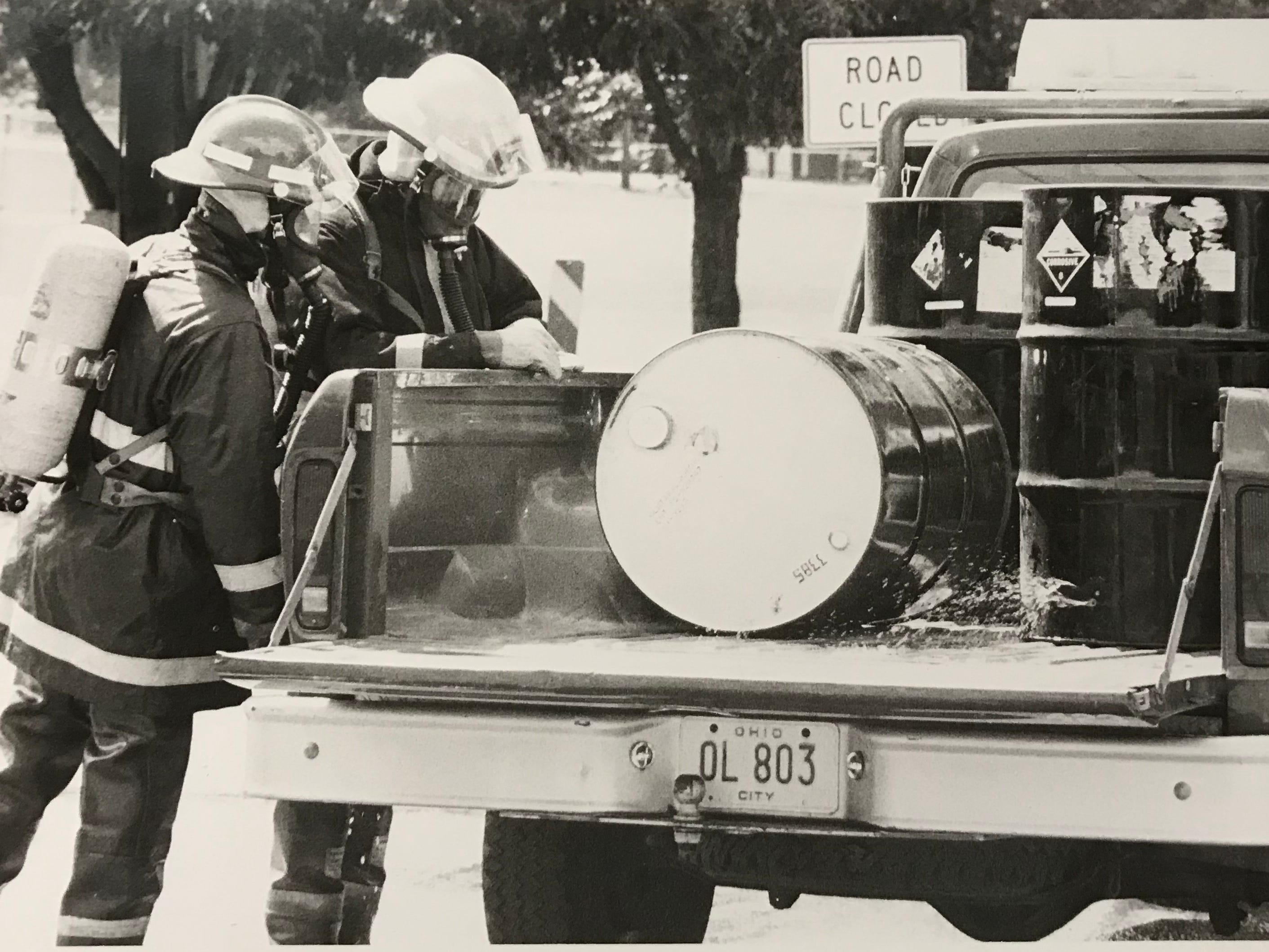 Chillicothe firefighters address corrosive materials spilled in the back of a truck in September 1983.