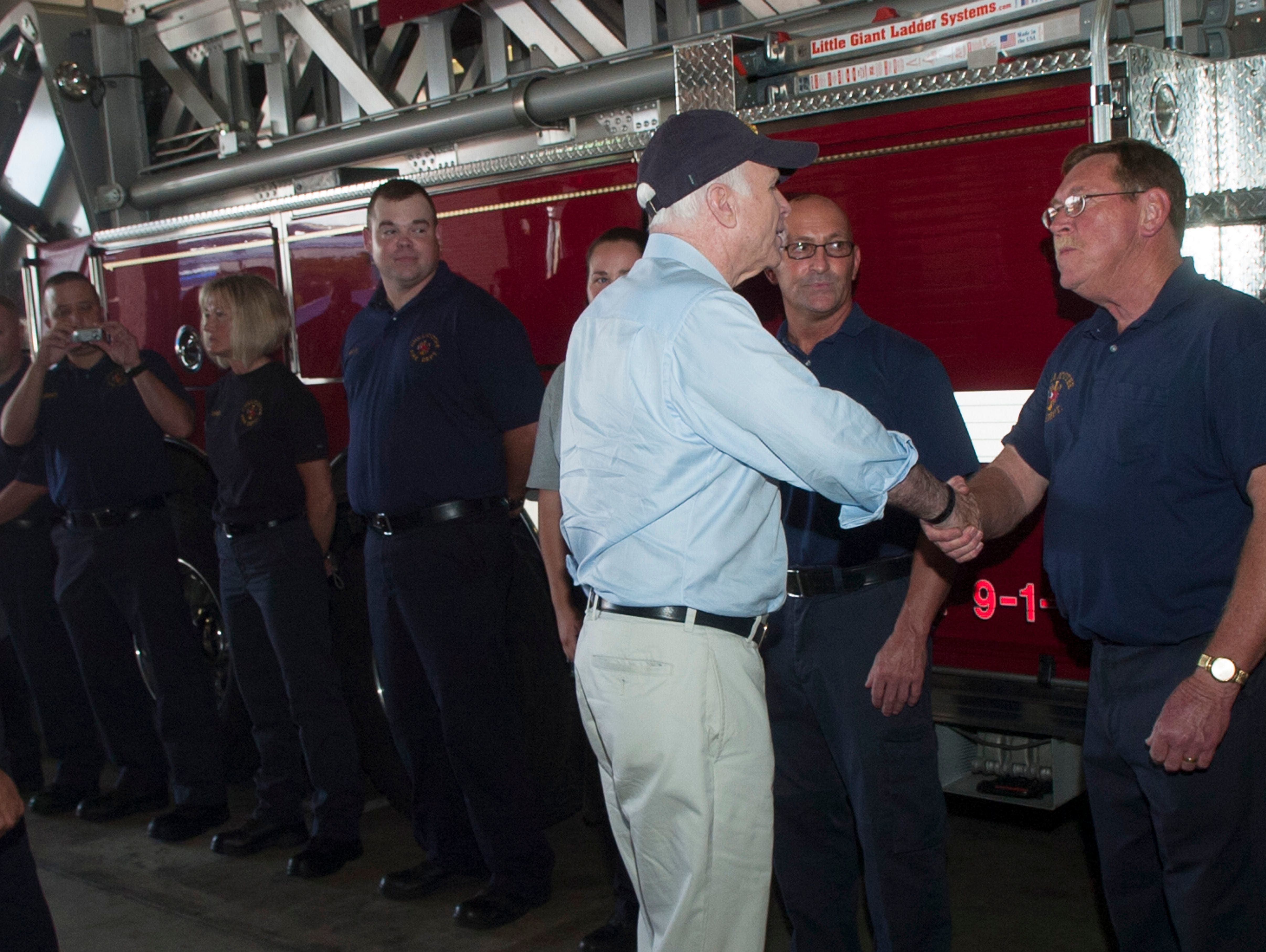 John McCain shakes hands as he walks through the main fire station of the Chillicothe Fire Department on August 6, 2008.