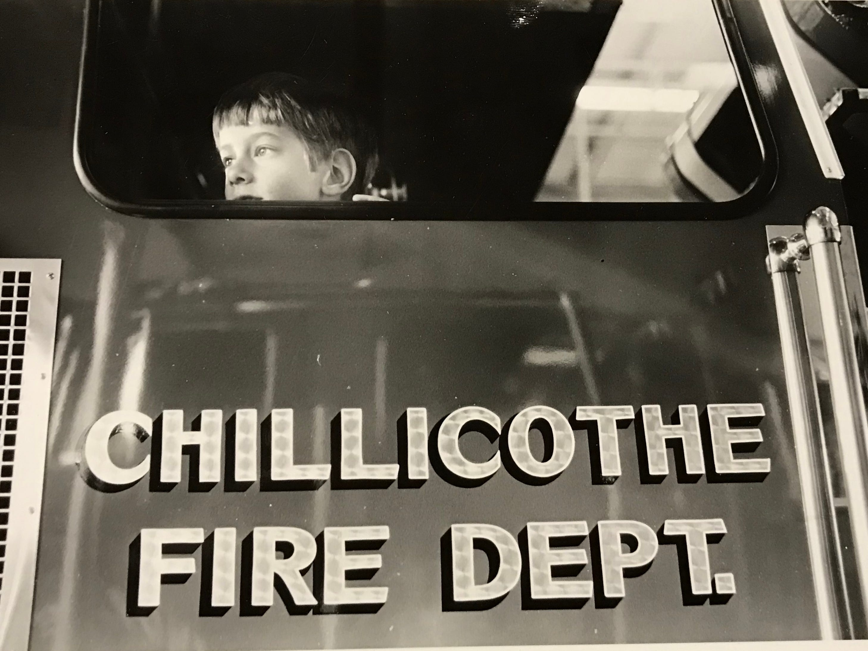David Dumbauld, 5, peaks out a fire truck window during the dedication of the new Station 1 on Water Street in August 1986.