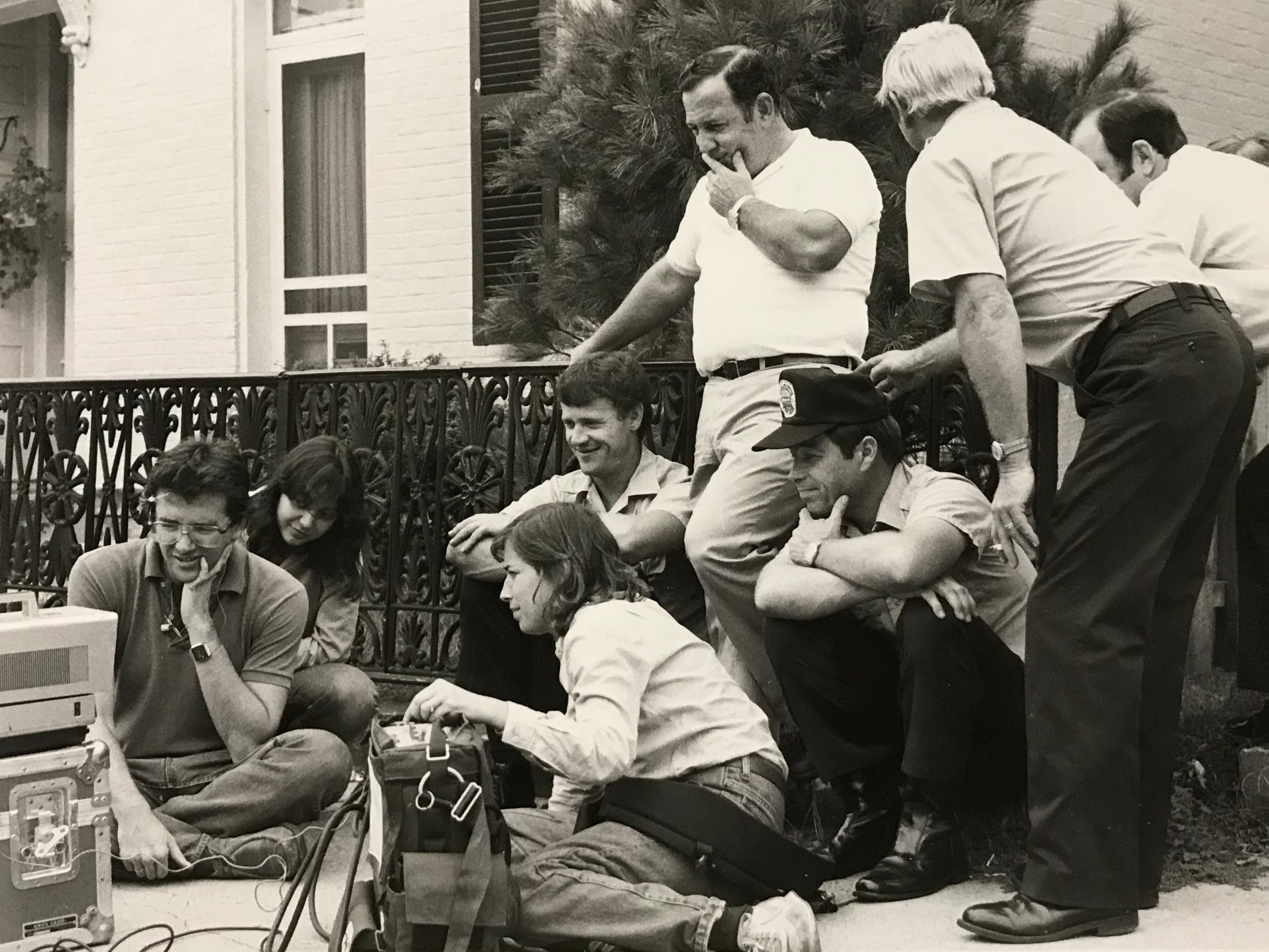 Chillicothe firefighters watch parts of a safety film along with those who helped make it in October 1984. The film featured some Chillicothe firefighters.