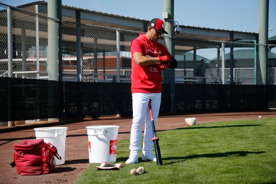 New signee Jose Iglesias tightens up his gloves at the Cincinnati Reds spring training facility in Goodyear, Ariz., on Saturday, Feb. 23, 2019.