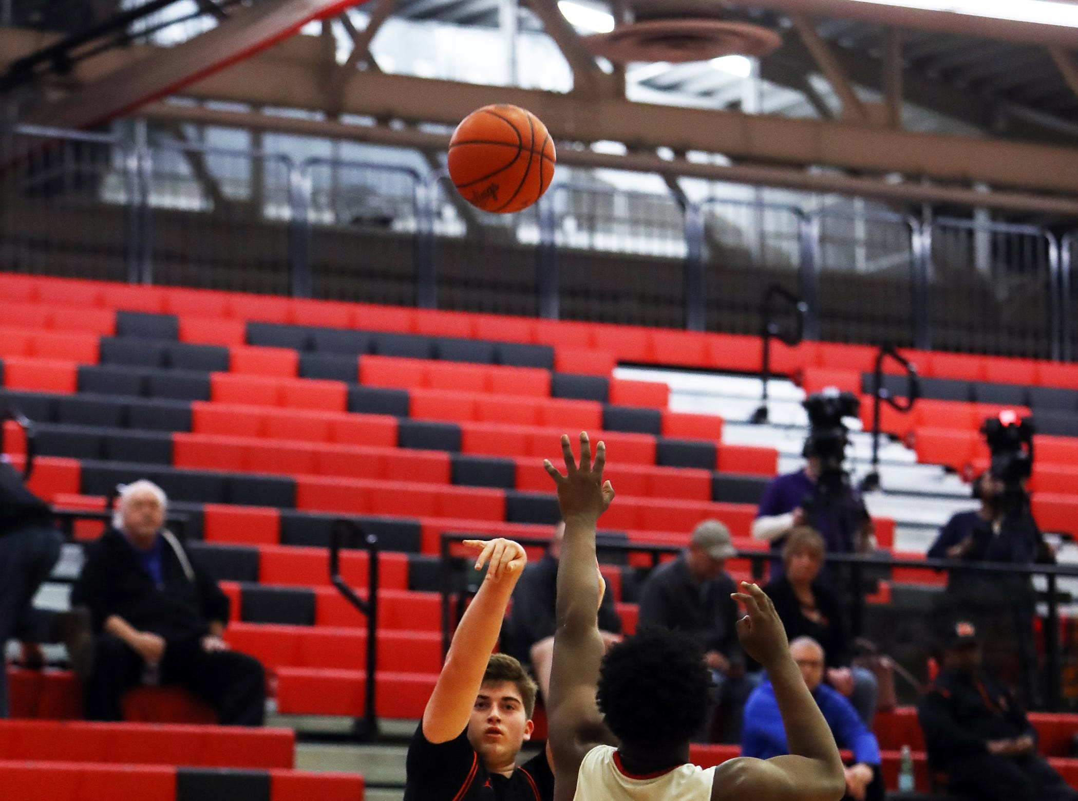 Loveland forward Alec Soth knocks down a three-point shot in the sectional playoffs at Lakota West High School Feb. 23, 2019.