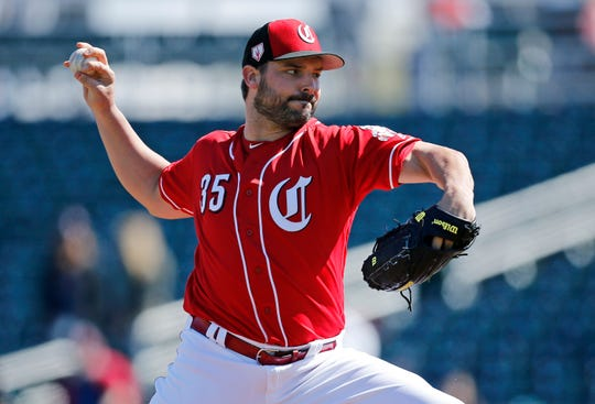Cincinnati Reds starting pitcher Tanner Roark (35) delivers a pitch in the first inning of the spring training opener between the Cleveland Indians and Cincinnati Reds at Goodyear Ballpark in Goodyear, Ariz., on Saturday, Feb. 23, 2019.