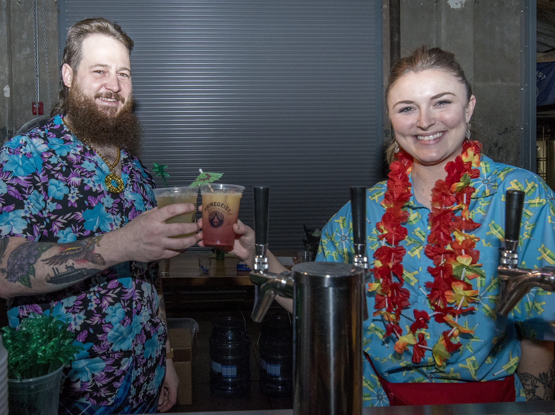 Rhinegiest employees Joe Vogel and Aislinn Brown toast with the fruit-infused beverages served at the tropical disco.