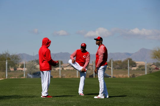 Cincinnati Reds relief pitcher Wandy Peralta (53) stretches out on a side field at the Cincinnati Reds spring training facility in Goodyear, Ariz., on Saturday, Feb. 23, 2019.