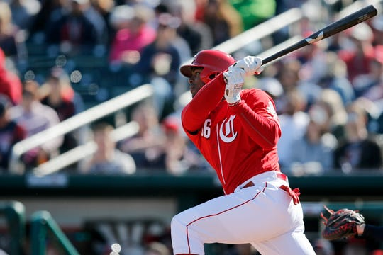 Cincinnati Reds right fielder Yasiel Puig (66) lines out to second in the second inning of the spring training opener between the Cleveland Indians and Cincinnati Reds at Goodyear Ballpark in Goodyear, Ariz., on Saturday, Feb. 23, 2019.