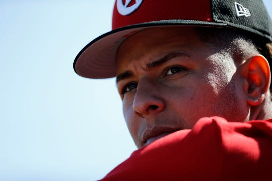 Cincinnati Reds starting pitcher Luis Castillo (58) watches from the dugout in the third inning of the spring training opener between the Cleveland Indians and Cincinnati Reds at Goodyear Ballpark in Goodyear, Ariz., on Saturday, Feb. 23, 2019.