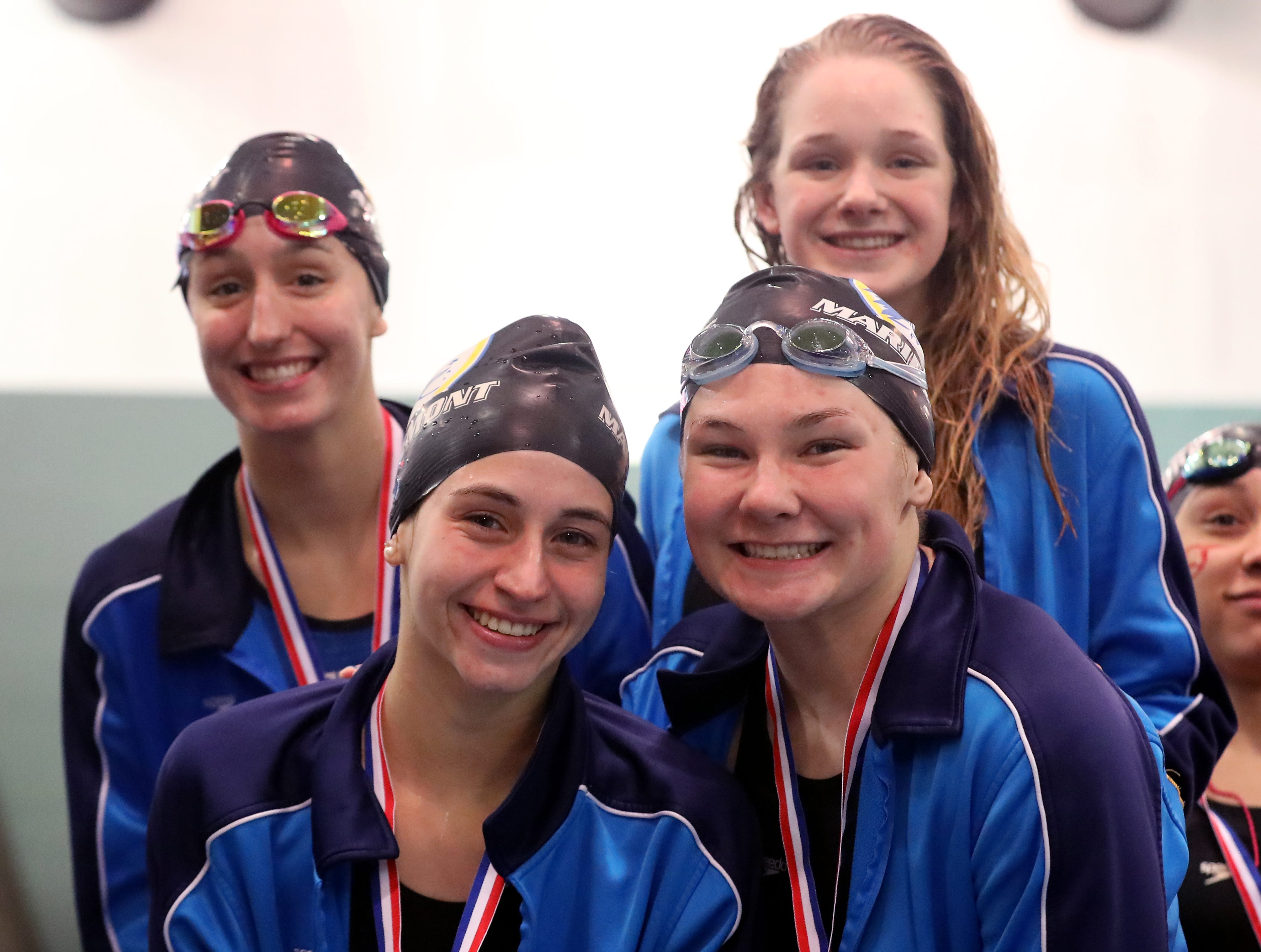 Members of the Mariemont girls 200 freestyle relay team with their medals at the OHSAA Swimming and Diving Championships in Canton, Ohio, Friday, Feb. 22, 2019