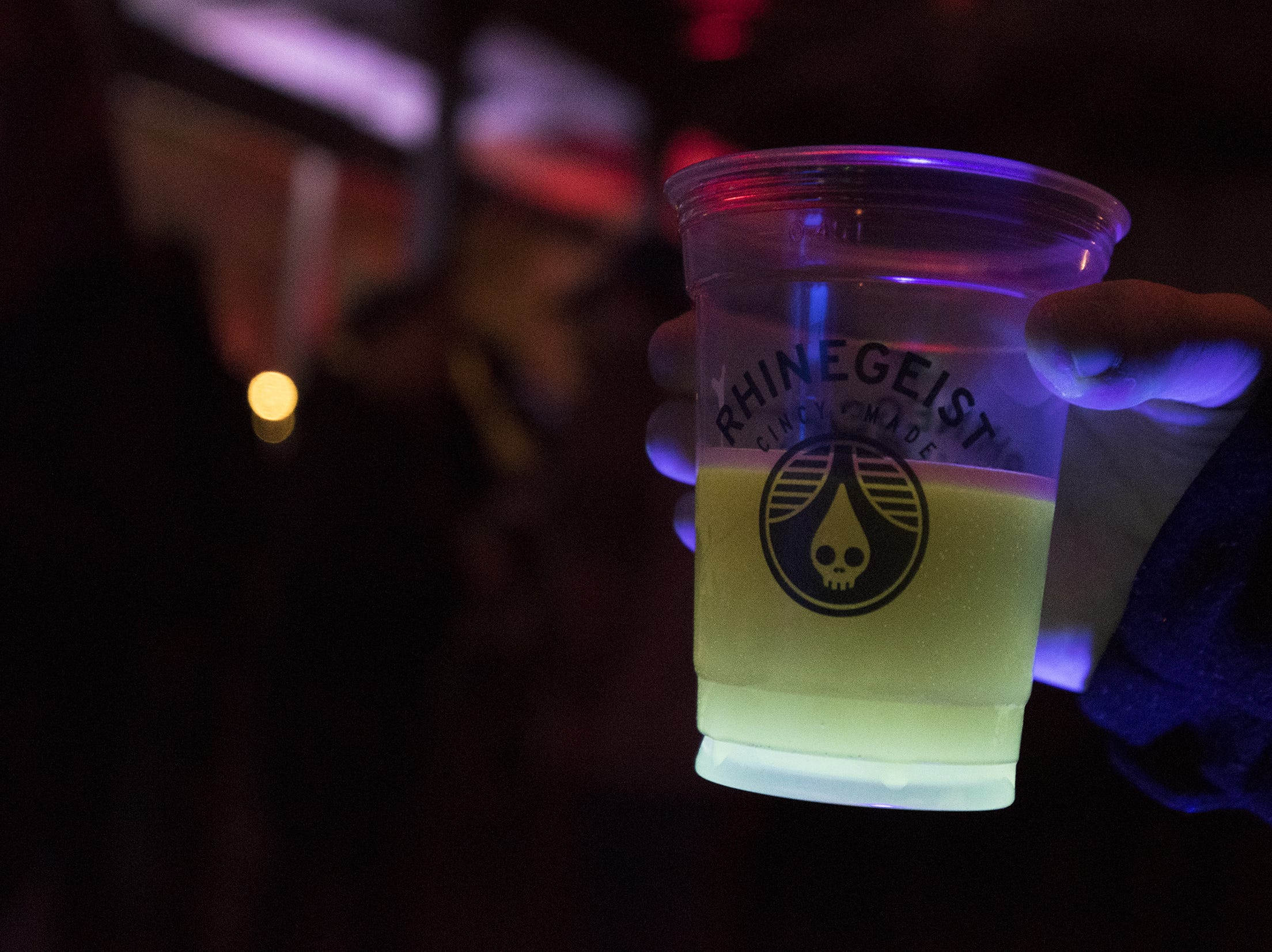 A beer is illuminated under black light at Rhinegeist's tropical disco.