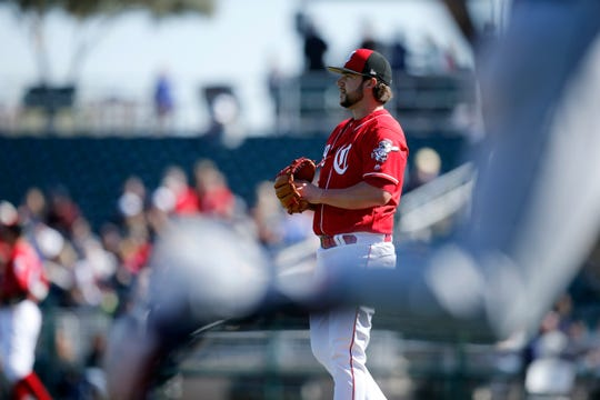 Cincinnati Reds pitcher Brandon Finnegan (29) reacts after giving up a home run to Cleveland Indians center fielder Tyler Naquin (30) in the top of the second inning of the spring training opener between the Cleveland Indians and Cincinnati Reds at Goodyear Ballpark in Goodyear, Ariz., on Saturday, Feb. 23, 2019.