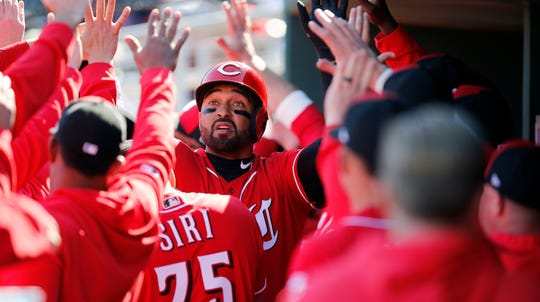 Cincinnati Reds designated hitter Matt Kemp (27) returns to the dugout after hitting a two-run home run in the bottom of the fourth inning of the spring training opener between the Cleveland Indians and Cincinnati Reds at Goodyear Ballpark in Goodyear, Ariz., on Saturday, Feb. 23, 2019.