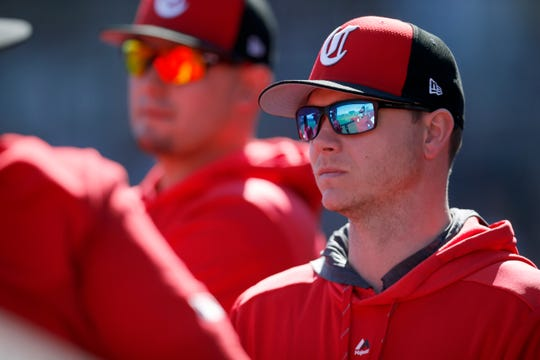 Cincinnati Reds starting pitcher Sonny Gray (54) walks through the dugout in the second inning of the spring training opener between the Cleveland Indians and Cincinnati Reds at Goodyear Ballpark in Goodyear, Ariz., on Saturday, Feb. 23, 2019.