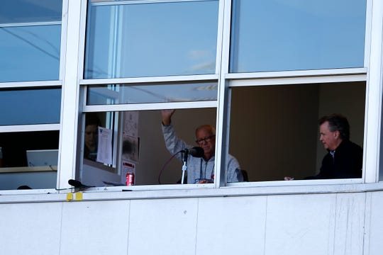 Reds broadcaster Marty Brennaman waves to fans as he's introduced during the fifth inning of the spring training opener between the Cleveland Indians and Cincinnati Reds at Goodyear Ballpark in Goodyear, Ariz., on Saturday, Feb. 23, 2019.