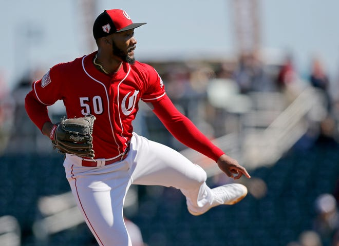 Cincinnati Reds relief pitcher Amir Garrett (50) throws a pitch in the fourth inning of the spring training opener between the Cleveland Indians and Cincinnati Reds at Goodyear Ballpark in Goodyear, Ariz., on Saturday, Feb. 23, 2019.