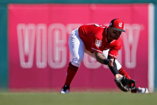 Cincinnati Reds second baseman Christian Colon (77) fields a ground ball off the bat of Cleveland Indians center fielder Tyler Naquin (30) in the third inning of the spring training opener between the Cleveland Indians and Cincinnati Reds at Goodyear Ballpark in Goodyear, Ariz., on Saturday, Feb. 23, 2019.
