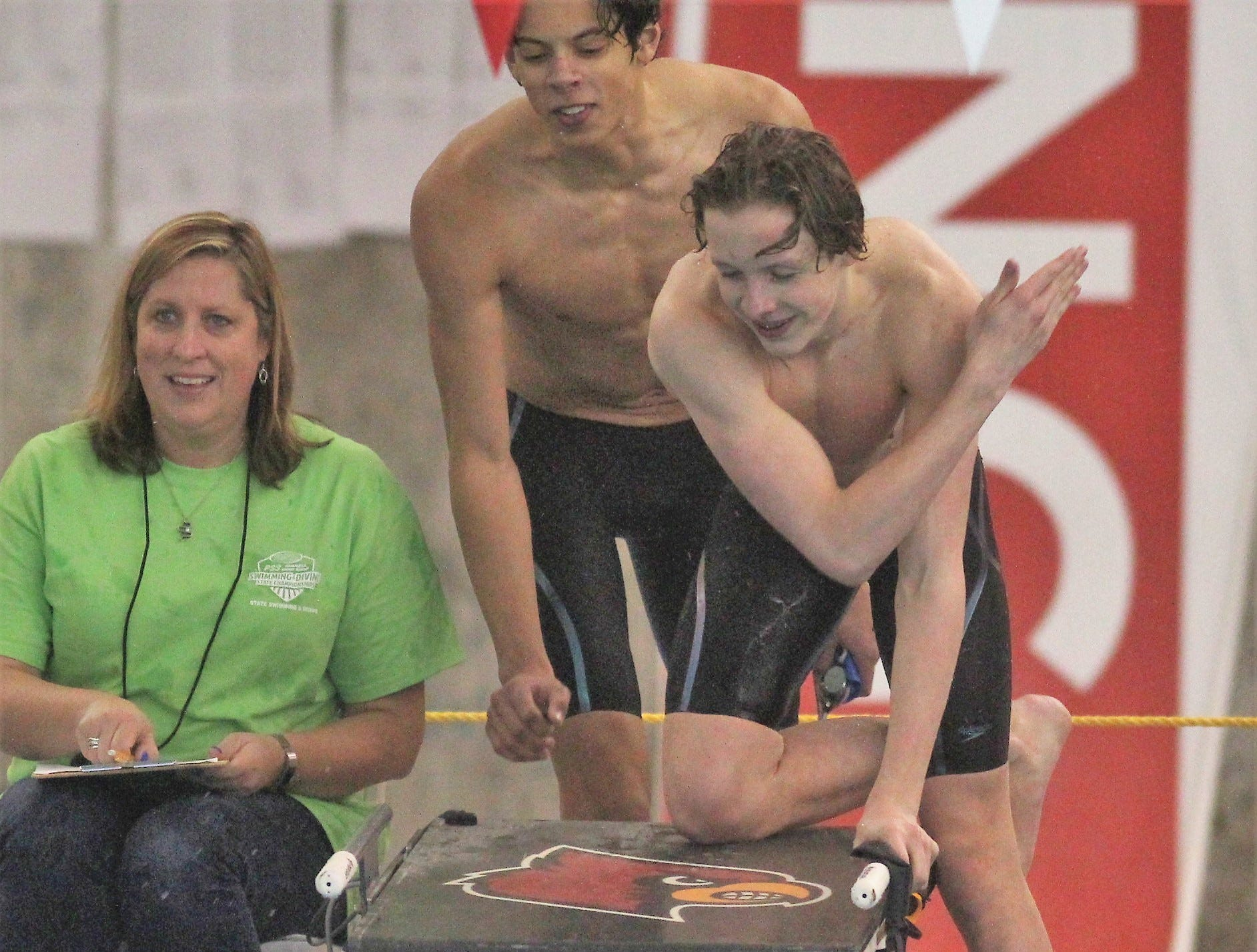 Highlands swimmers celebrate with Brendan Conley after they finished second in the 400 free relay with a school record time, 2019 state meet.