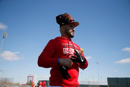 Cincinnati Reds third baseman Eugenio Suarez (7) wraps up on the batting practice field at the Cincinnati Reds spring training facility in Goodyear, Ariz., on Saturday, Feb. 23, 2019.