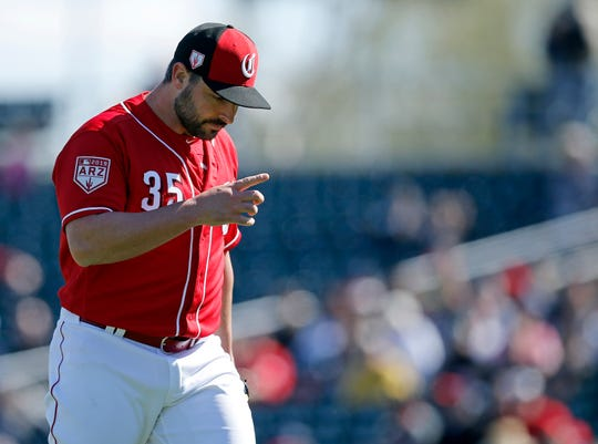 Cincinnati Reds starting pitcher Tanner Roark (35) returns to the dugout after his outing in the first inning of the spring training opener between the Cleveland Indians and Cincinnati Reds at Goodyear Ballpark in Goodyear, Ariz., on Saturday, Feb. 23, 2019.
