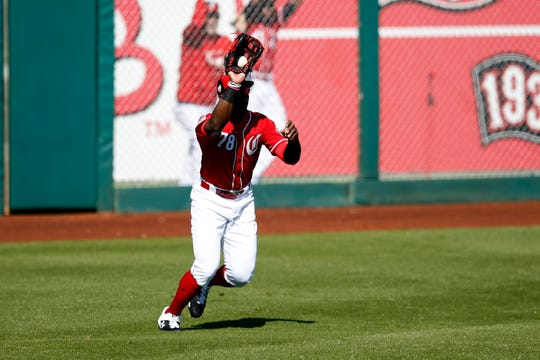 Cincinnati Reds center fielder Taylor Trammell (78) makes a play from deep left field in the top of the sixth inning of the spring training opener between the Cleveland Indians and Cincinnati Reds at Goodyear Ballpark in Goodyear, Ariz., on Saturday, Feb. 23, 2019.