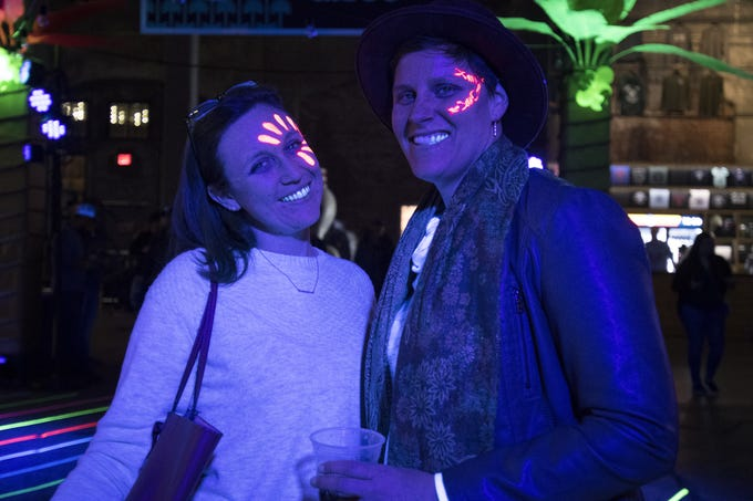 Lindsey Oliphant and Dawn Sanderson boogie under black lights during a tropical disco at Rhinegeist Friday, February 22, 2019 in Cincinnati, Ohio.