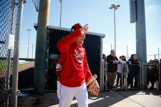 Cincinnati Reds second baseman Scooter Gennett (3) waves to fans as he leaves a field at the Cincinnati Reds spring training facility in Goodyear, Ariz., on Saturday, Feb. 23, 2019.
