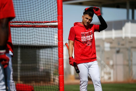 New Reds signee Jose Iglesias comes out of the cage after a round of batting practice at the Cincinnati Reds spring training facility in Goodyear, Ariz., on Saturday, Feb. 23, 2019.