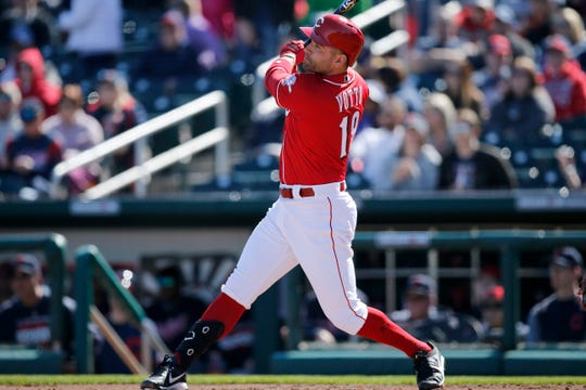 Cincinnati Reds first baseman Joey Votto (19) takes a swing in the bottom of the first inning of the spring training opener between the Cleveland Indians and Cincinnati Reds at Goodyear Ballpark in Goodyear, Ariz., on Saturday, Feb. 23, 2019.