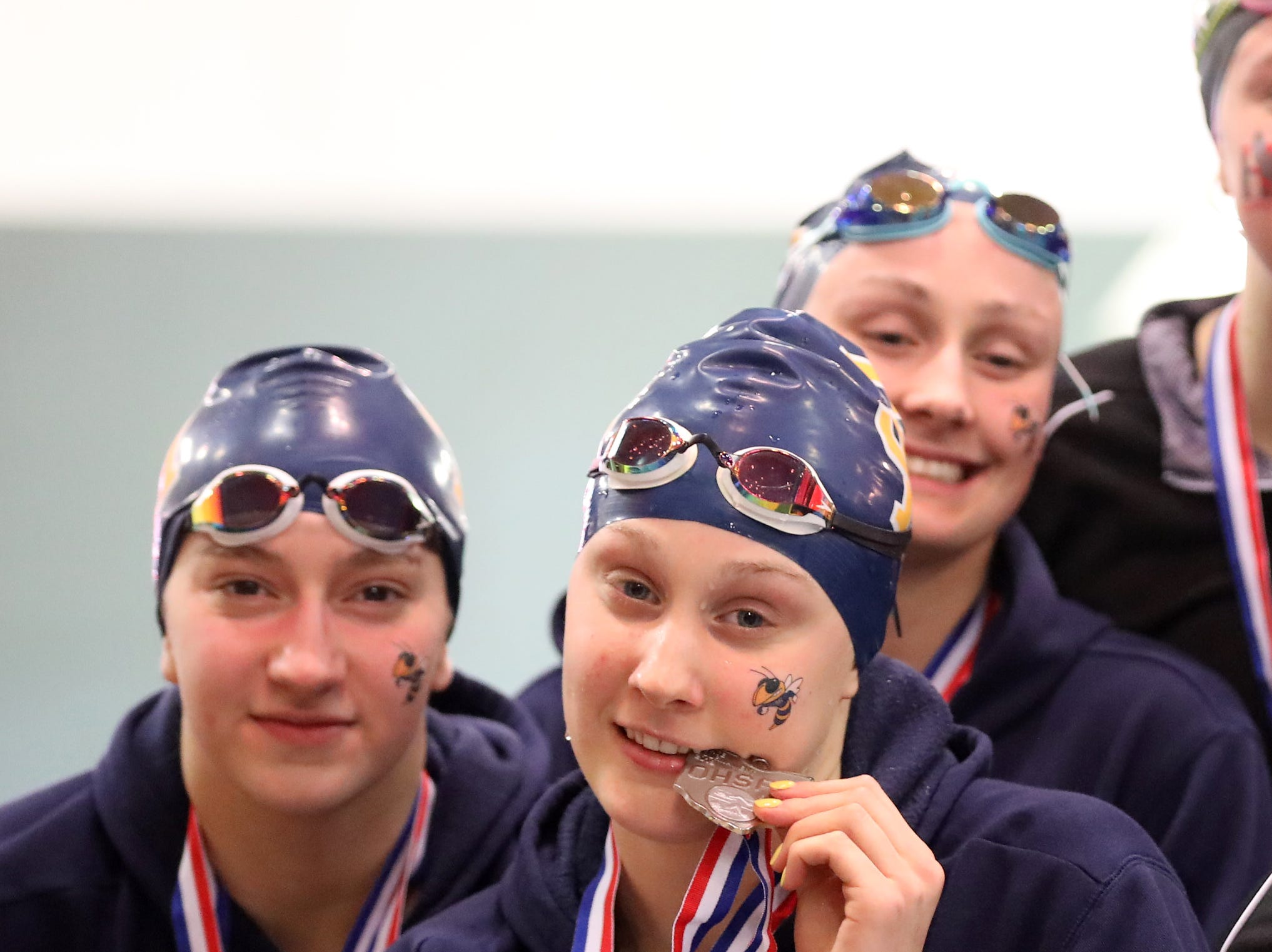 Seven Hills girls relay team with theirmedals at the OHSAA Swimming and Diving Championships in Canton, Ohio, Friday, Feb. 22, 2019.
