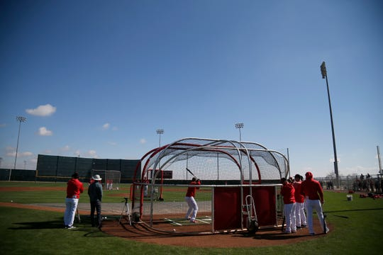 Players run through batting practice at the Cincinnati Reds spring training facility in Goodyear, Ariz., on Saturday, Feb. 23, 2019.