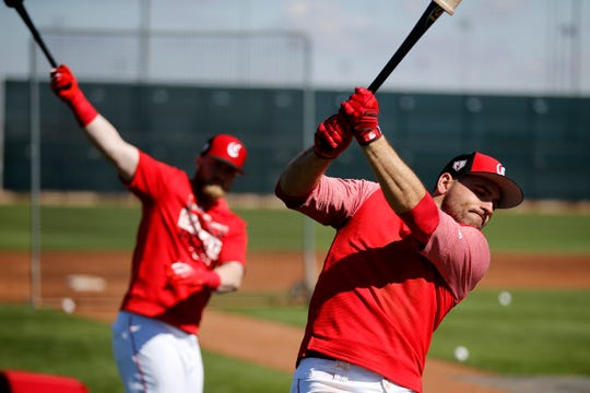 Cincinnati Reds catcher Tucker Barnhart (16) and first baseman Joey Votto (19) take slow swings before batting practice at the Cincinnati Reds spring training facility in Goodyear, Ariz., on Saturday, Feb. 23, 2019.