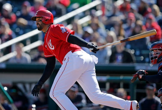 Cincinnati Reds designated hitter Matt Kemp (27) runs for first on a lineup to third in the bottom of the first inning of the spring training opener between the Cleveland Indians and Cincinnati Reds at Goodyear Ballpark in Goodyear, Ariz., on Saturday, Feb. 23, 2019.