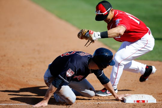 Cincinnati Reds third baseman Connor Joe (17) tags out Cleveland Indians right fielder Mike Papi (83) at third base in the sixth inning of the spring training opener between the Cleveland Indians and Cincinnati Reds at Goodyear Ballpark in Goodyear, Ariz., on Saturday, Feb. 23, 2019.