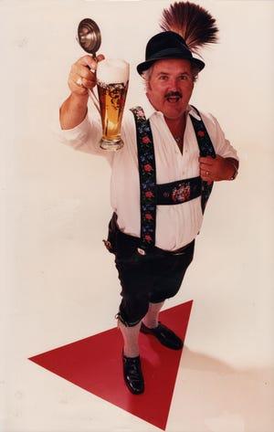 George Fraundorfer raises a stein to Oktoberfest Zinzinnati, of which he was a founding member.