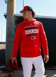 Cincinnati Reds starting pitcher Luis Castillo (58) heads to a different drill at the Cincinnati Reds spring training facility in Goodyear, Ariz., on Saturday, Feb. 23, 2019.