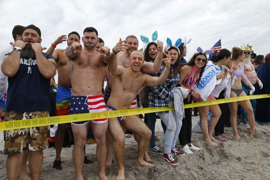Plungers participate in the Seaside Heights Polar Plunge for Special Olympics on the beach in Seaside Heights,NJ. Saturday, February 23, 2019. Noah K. Murray-Correspondent/Asbury Park Press