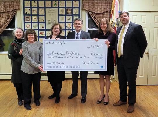Stanton Holly Trail presented a donation of $21,700 to Hunterdon Healthcare Foundation towards improvements at Briteside Adult Day Center. (Left to right): Amy Coss, Holly Trail co-chair; Karyn Fiedler, lead sponsor from Provident Bank; Catherine Siessel, director, Briteside Adult Day Center; Patrick Gavin, president and CEO, Hunterdon Healthcare System; Suzanne Schwanda, Holly Trail co-chair; and Phil Beekman, senior vice president , Hunterdon Healthcare Foundation.