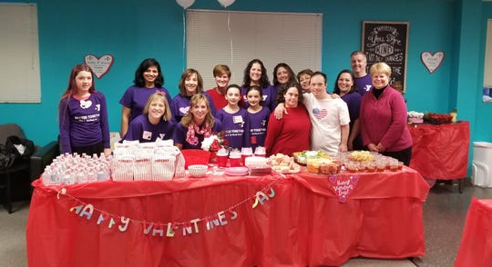 Hillsborough YMCA staff and volunteers, GiGi's Playhouse staff and Sweetheart Dance guests gather for a group photo.
