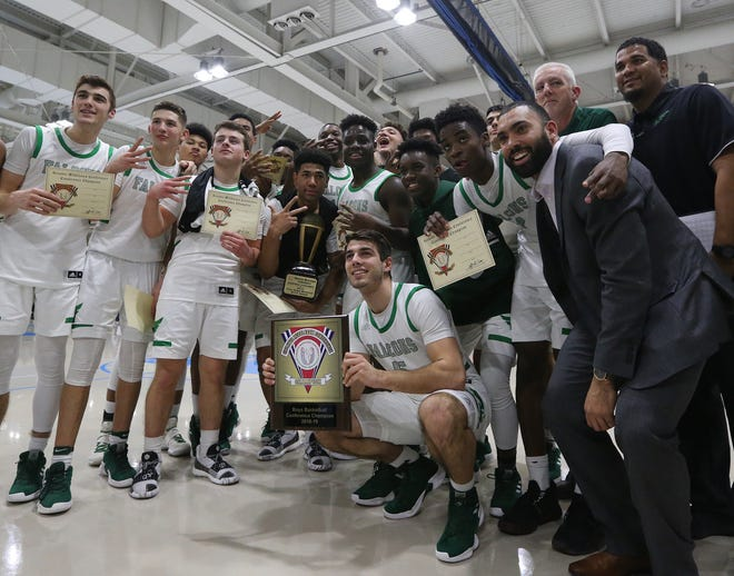 The St. Joseph (Met.) basketball team celebrates its win over Piscataway in the GMC Tournament final on Friday, Feb. 22, 2019 at Middlesex County College.