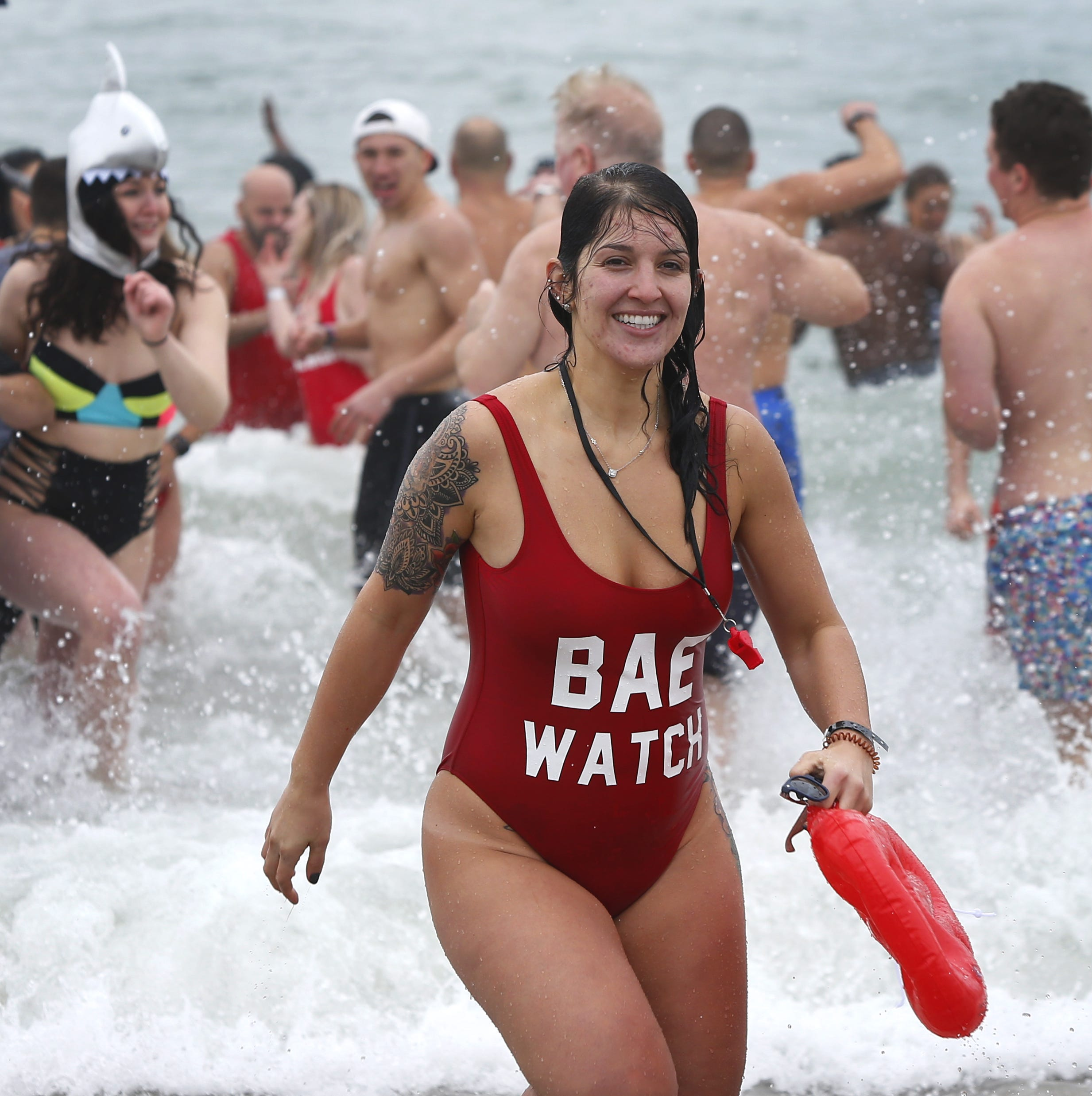 Polar plungers take a dip in Seaside for Special Olympics