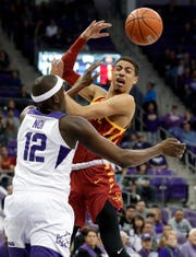 TCU forward Kouat Noi (12) blocks the lane forcing Iowa State guard Tyrese Haliburton (22) to pass the ball in the first half of an NCAA college basketball game in Fort Worth, Texas, Saturday, Feb. 23, 2019.