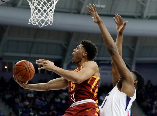 Iowa State guard Lindell Wigginton (5) gets past TCU center Kevin Samuel (21) for a shot in the first half of an NCAA college basketball game in Fort Worth, Texas, Saturday, Feb. 23, 2019.