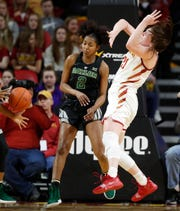 Iowa State guard Bridget Carleton, right, loses the ball in front of Baylor guard DiDi Richards (2) during the second half of an NCAA college basketball game Saturday in Ames.