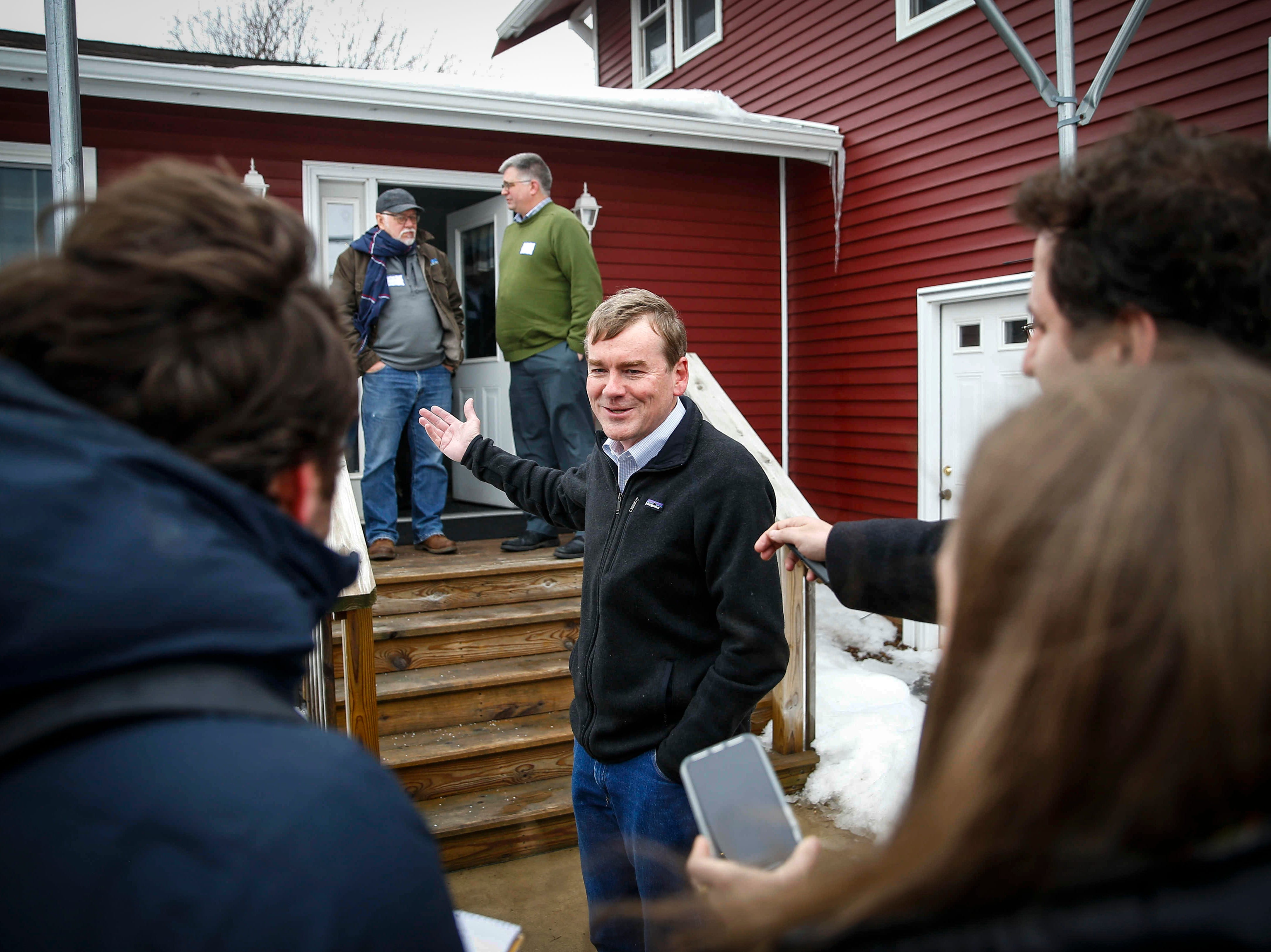 United States Sen. Michael Bennet from Colorado talks to members of the media on Saturday, Feb. 23, 2019, at the Lehman farm in rural Polk City.