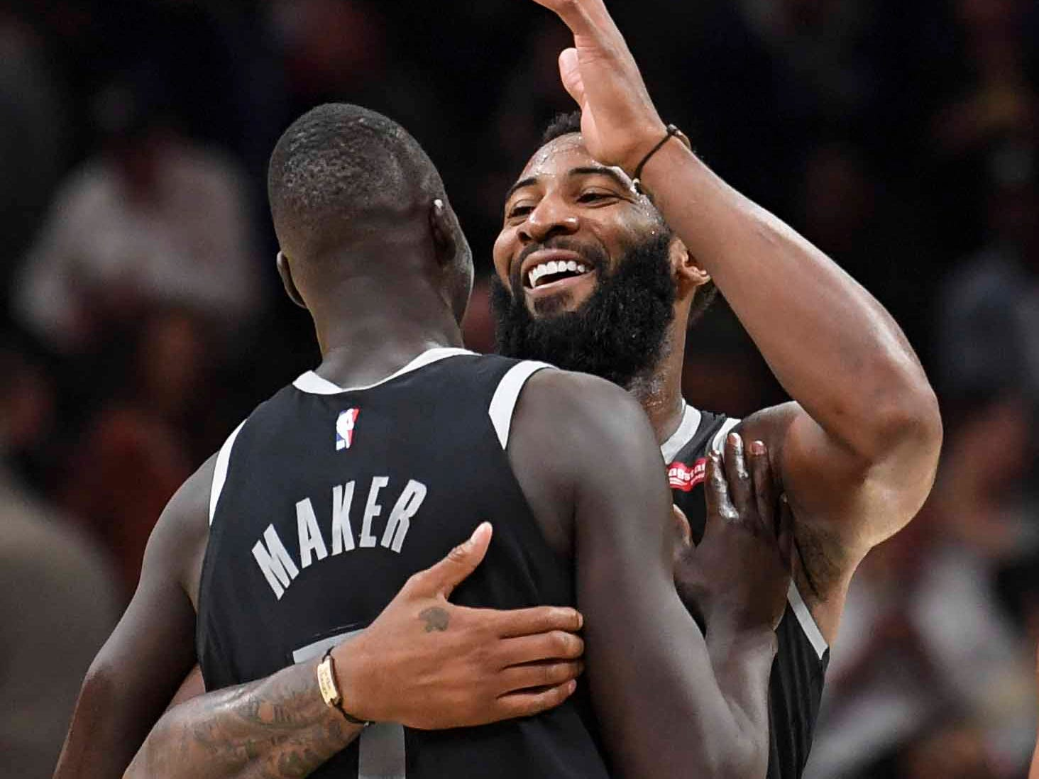Detroit Pistons center Andre Drummond (0) reacts with forward Thon Maker (7) after the Pistons defeated the Atlanta Hawks at State Farm Arena on Feb. 22, 2019.