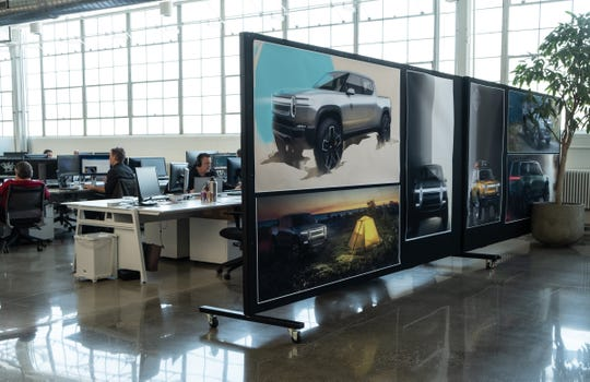 Drawings for Rivian electric vehicles are seen in the design studio of the startup in Plymouth on Thursday, February 21, 2019.