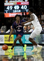 Detroit Mercy's Antoine Davis drives against Oakland's Tray Maddox during the second half at the O'rena in Rochester, Saturday.