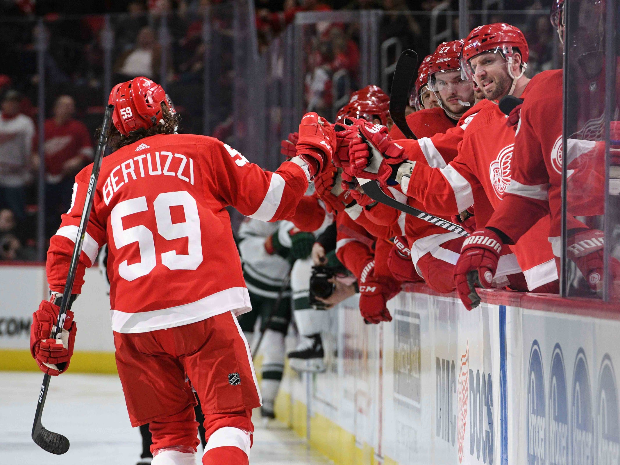 Detroit Red Wings left wing Tyler Bertuzzi (59) celebrates his goal with teammates during the second period against the Minnesota Wild at Little Caesars Arena on Feb. 22, 2019.