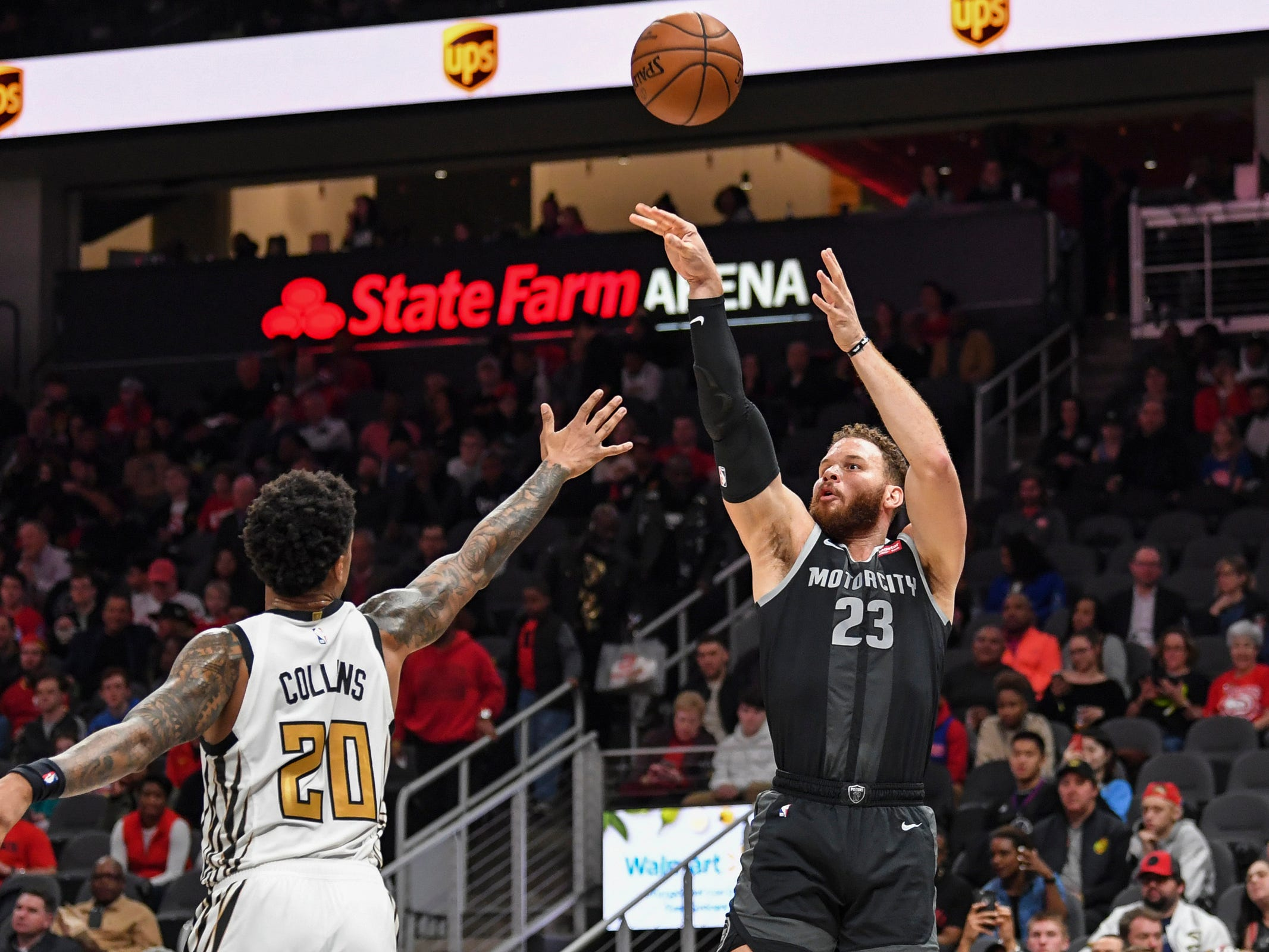 Detroit Pistons forward Blake Griffin (23) shoots the ball over Atlanta Hawks forward John Collins (20) during the first half at State Farm Arena on Feb. 22, 2019.