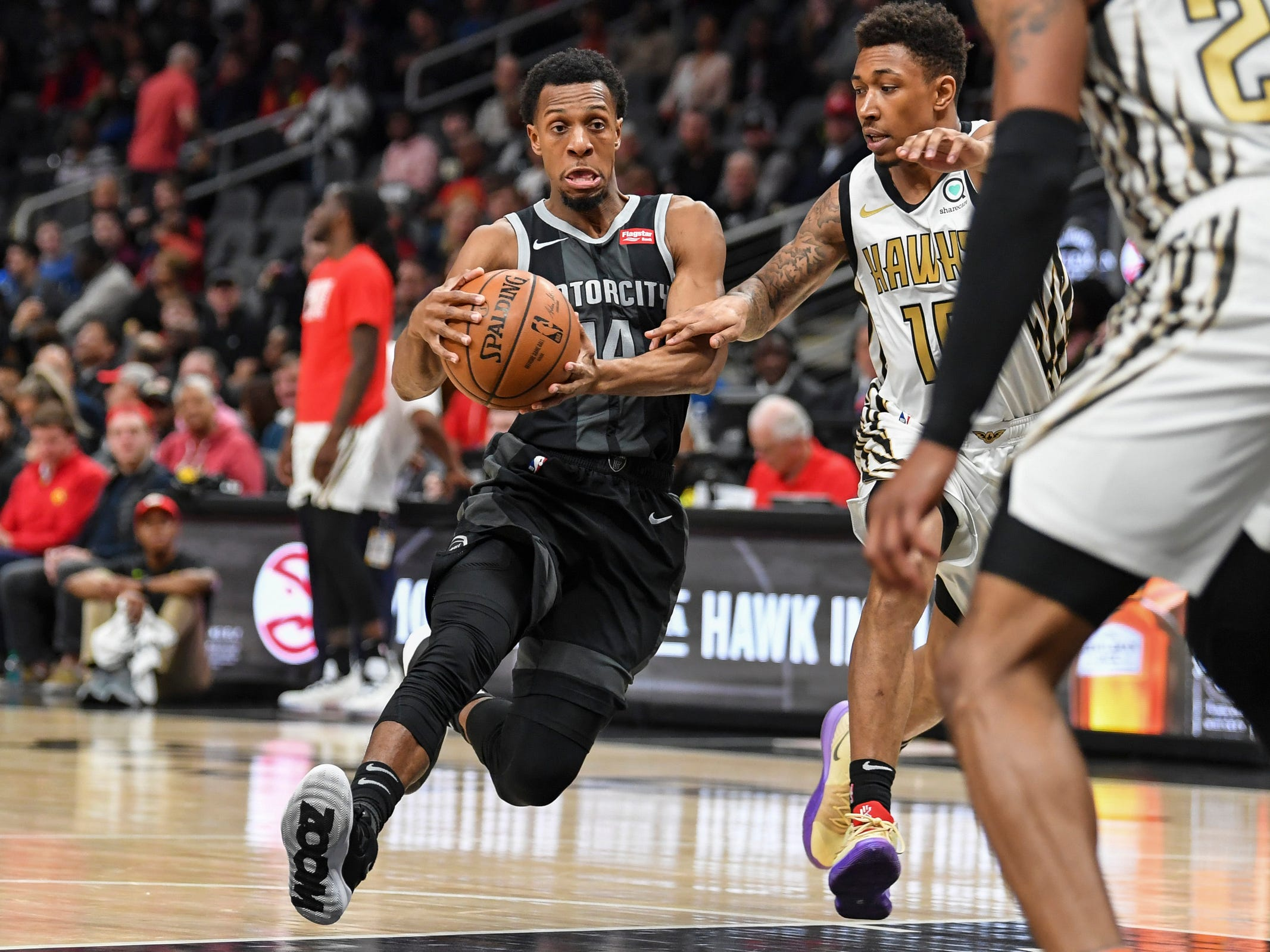 Detroit Pistons guard Ish Smith (14) dribbles the ball as Atlanta Hawks guard Jaylen Adams (10) defends during the first half at State Farm Arena on Feb. 22, 2019.